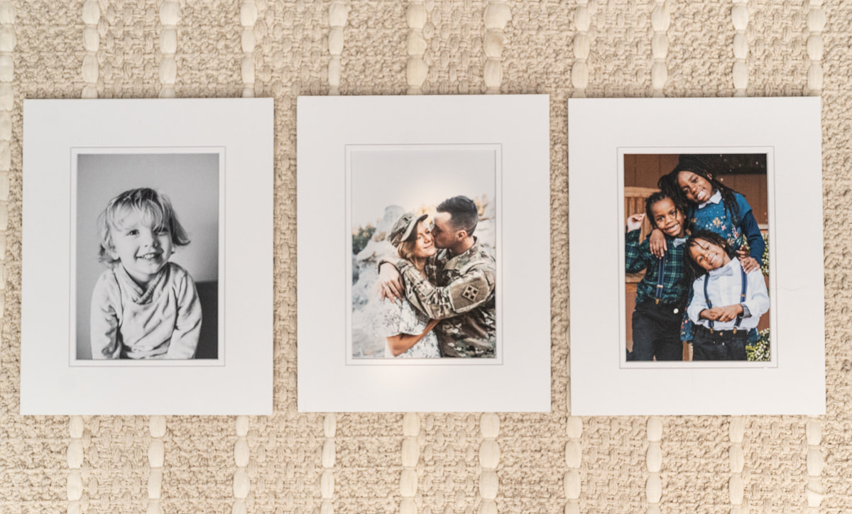 three matted photographs on a rug