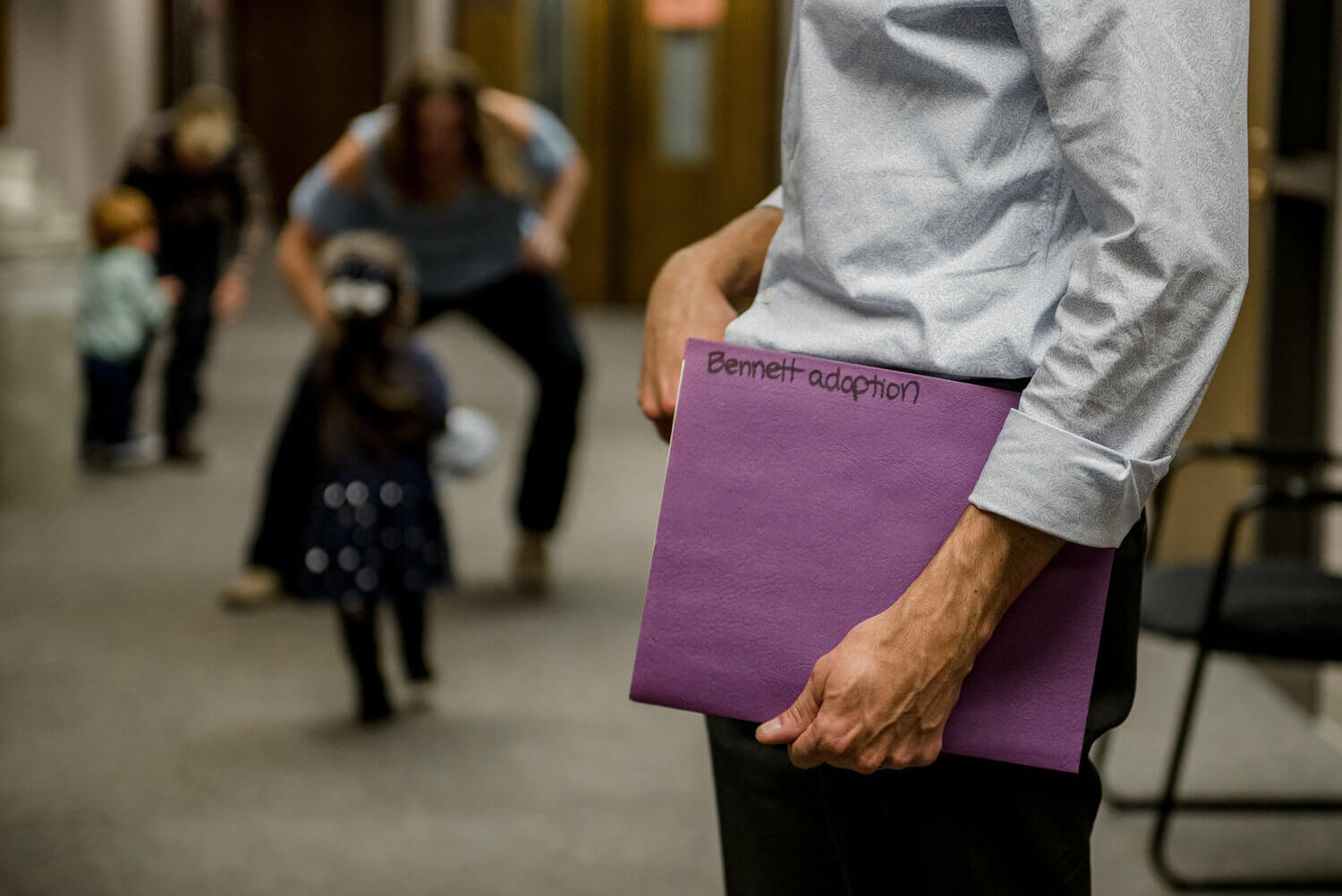 man holding purple folder